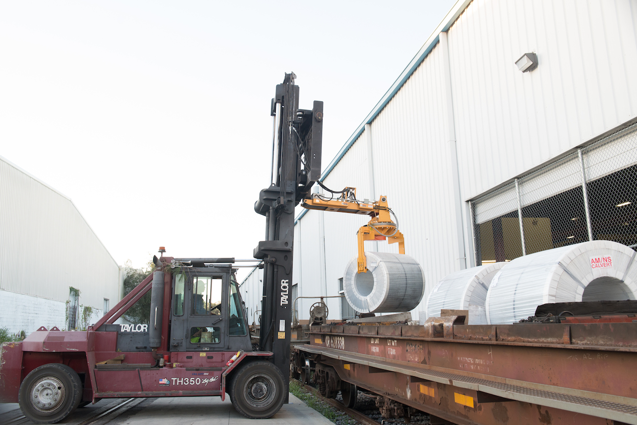 MiTek receives the steel coils in batches of six or seven aboard each railcar.