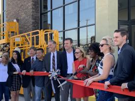 Mayor Acquanetta Warren (third from right) and Alice Bamford join JCB executives and local dignitaries to cut the ribbon to commemorate the opening of the new SoCal JCB premises in Fontana, California.